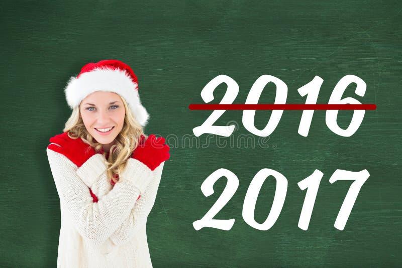 Σύνθετη εικόνα ευτυχούς εορταστικού ξανθού στοκ εικόνα με δικαίωμα ελεύθερης χρήσης