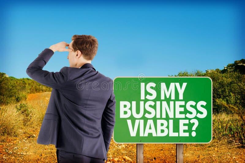 Σύνθετη εικόνα της άποψης ένδυσης του κοιτάγματος επιχειρηματιών μακριά στοκ φωτογραφίες