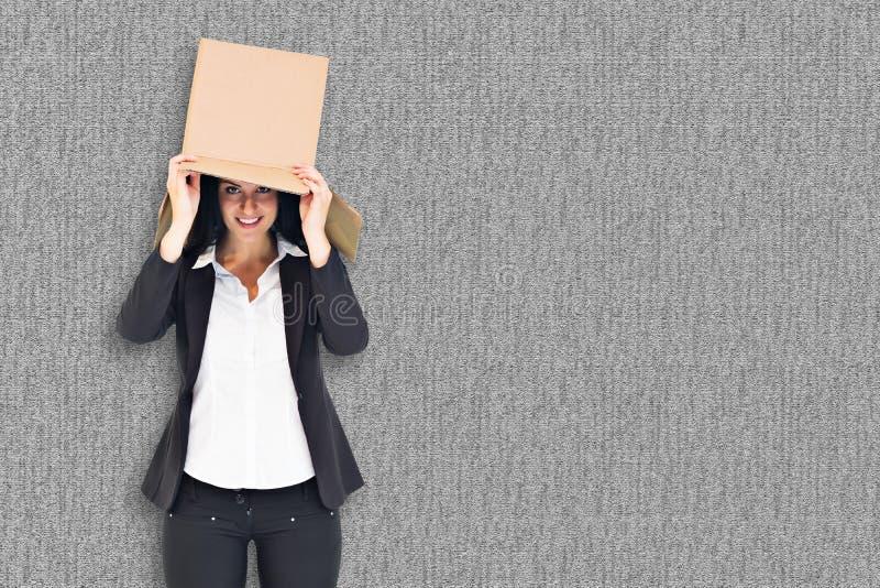 Σύνθετη εικόνα της ανώνυμης επιχειρηματία που κρατά megaphone στοκ φωτογραφίες