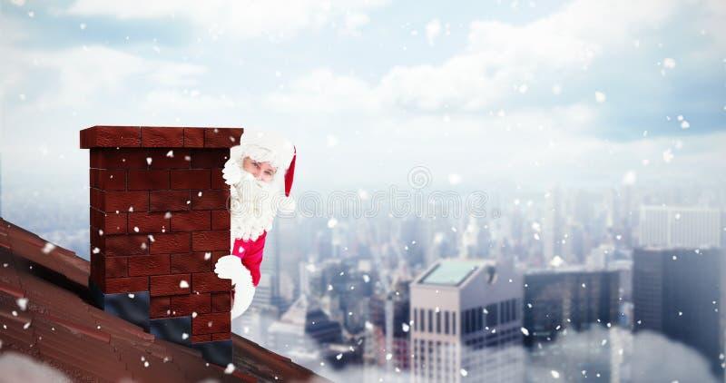 Σύνθετη εικόνα της ευτυχούς αφίσας εκμετάλλευσης Άγιου Βασίλη στοκ φωτογραφίες με δικαίωμα ελεύθερης χρήσης