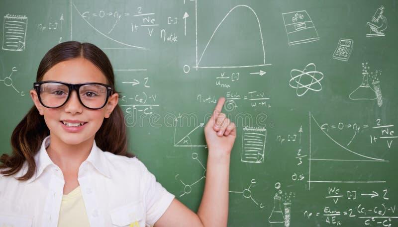 Σύνθετη εικόνα της χαριτωμένης υπόδειξης μαθητών στοκ φωτογραφίες