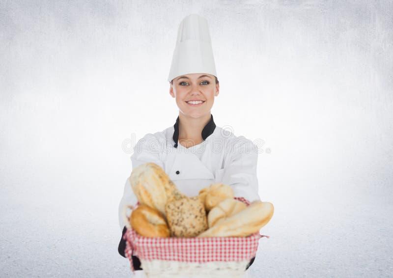 Σύνθετη εικόνα του αρχιμάγειρα με το ψωμί στο άσπρο κλίμα στοκ εικόνα με δικαίωμα ελεύθερης χρήσης