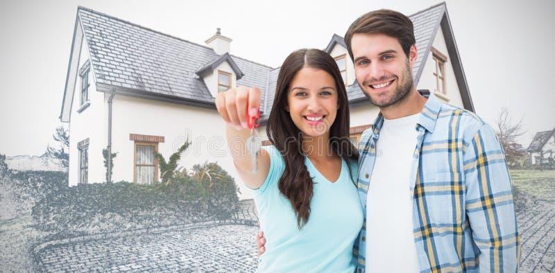 Σύνθετη εικόνα του ευτυχούς νέου ζεύγους που παρουσιάζει κλειδί καινούργιων σπιτιών στοκ φωτογραφίες με δικαίωμα ελεύθερης χρήσης