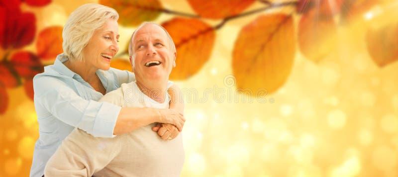 Σύνθετη εικόνα του ευτυχούς ώριμου ζεύγους που χαμογελά το ένα στο άλλο στοκ εικόνα