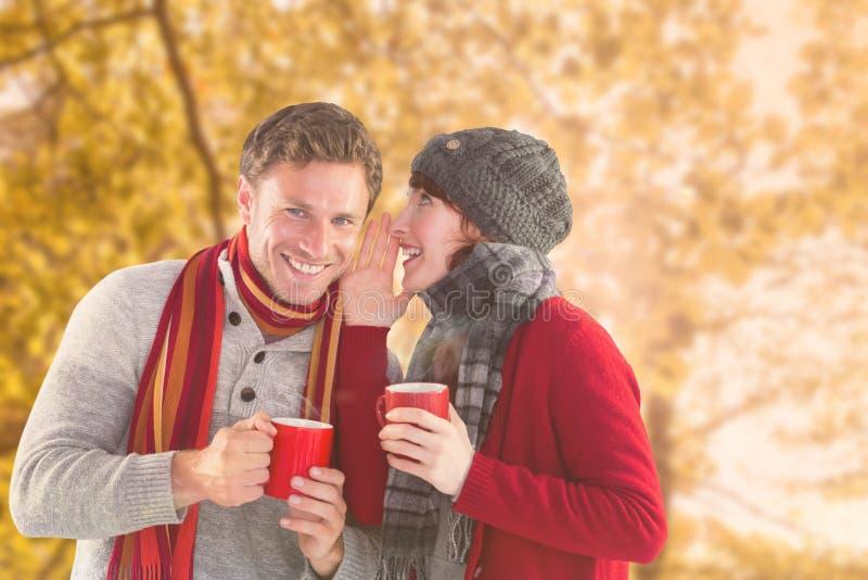 Σύνθετη εικόνα του ζεύγους και οι δύο που έχουν τα θερμά ποτά στοκ φωτογραφία