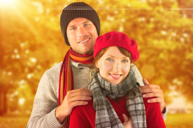 Σύνθετη εικόνα του ζεύγους που χαμογελά στη κάμερα στοκ εικόνες