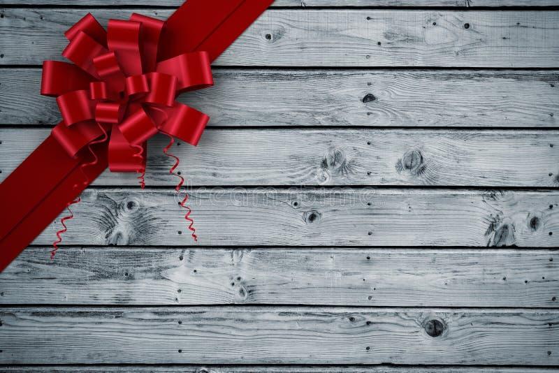 Σύνθετη εικόνα του κόκκινων τόξου και της κορδέλλας Χριστουγέννων ελεύθερη απεικόνιση δικαιώματος