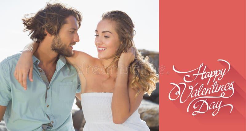 Σύνθετη εικόνα του πανέμορφου ζεύγους που αγκαλιάζει στην ακτή στοκ φωτογραφίες