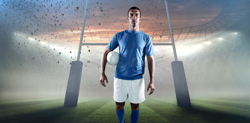 Σύνθετη εικόνα του πορτρέτου του κοιτάγματος φορέων ράγκμπι μακριά κρατώντας τη σφαίρα κατά μέρος στοκ φωτογραφίες με δικαίωμα ελεύθερης χρήσης
