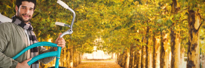 Σύνθετη εικόνα του πορτρέτου του χαμόγελου του φέρνοντας ποδηλάτου νεαρών άνδρων στοκ φωτογραφία με δικαίωμα ελεύθερης χρήσης