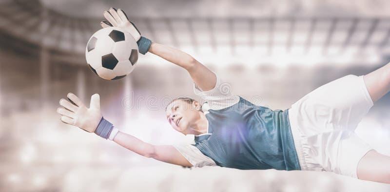 Σύνθετη εικόνα του τερματοφύλακασς γυναικών που σταματά έναν στόχο στοκ φωτογραφίες με δικαίωμα ελεύθερης χρήσης
