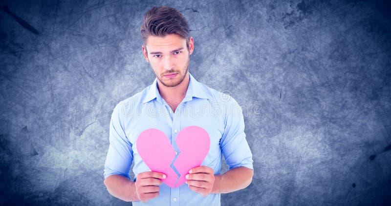 Σύνθετη εικόνα του λυπημένου ατόμου που κρατά μια σπασμένη καρδιά στοκ εικόνα με δικαίωμα ελεύθερης χρήσης