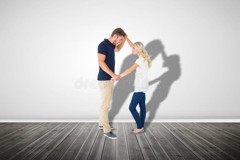 Σύνθετη εικόνα του υ ατόμου που εξουδετερώνει τη φίλη του στοκ φωτογραφία με δικαίωμα ελεύθερης χρήσης