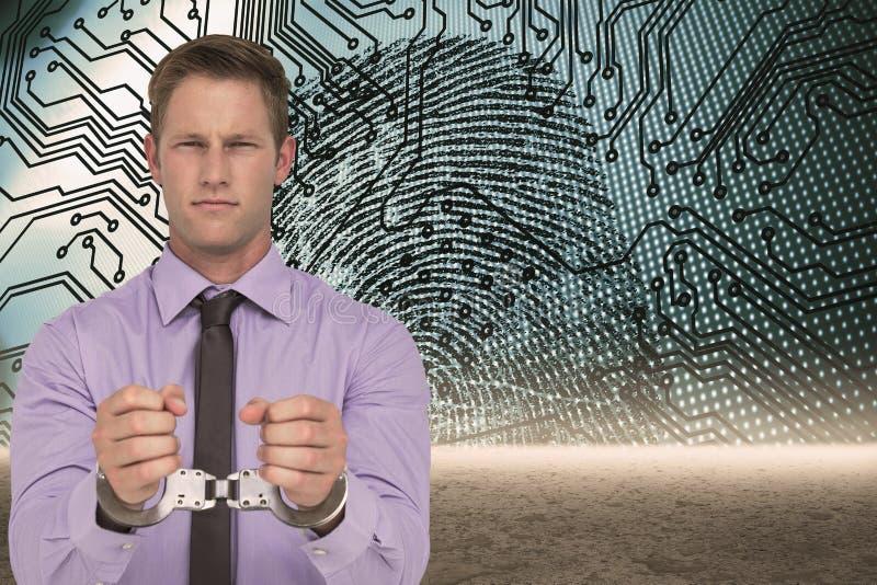 Σύνθετη εικόνα του όμορφου επιχειρηματία που φορά τις χειροπέδες στοκ εικόνα με δικαίωμα ελεύθερης χρήσης