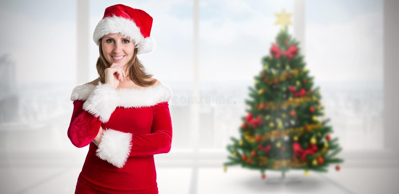 Σύνθετη εικόνα του όμορφου κοριτσιού στην εξάρτηση santa στοκ φωτογραφίες