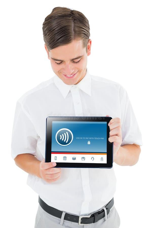 Σύνθετη εικόνα του geeky επιχειρηματία που παρουσιάζει PC ταμπλετών του στοκ εικόνα