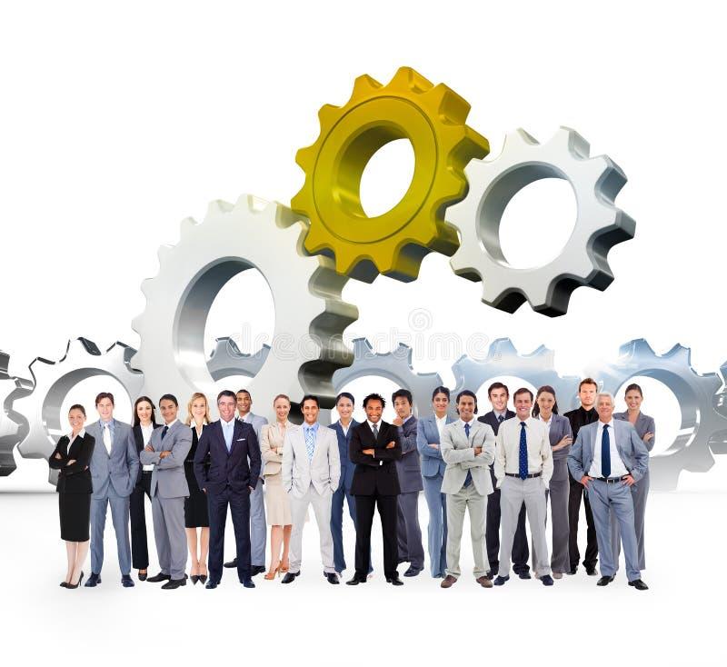 Σύνθετη εικόνα των επιχειρηματιών που στέκονται επάνω στοκ φωτογραφίες