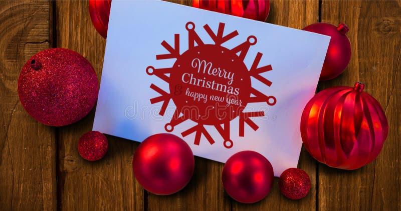 Σύνθετη εικόνα των κόκκινων μπιχλιμπιδιών Χριστουγέννων που περιβάλλουν την άσπρη σελίδα ελεύθερη απεικόνιση δικαιώματος