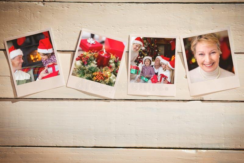 Σύνθετη εικόνα των στιγμιαίων φωτογραφιών στο ξύλινο πάτωμα στοκ φωτογραφίες