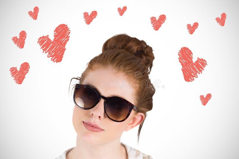 Σύνθετη εικόνα των redhead φορώντας μεγάλων γυαλιών ηλίου hipster στοκ εικόνες