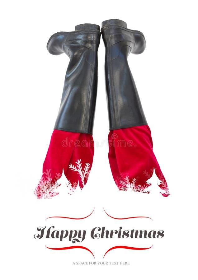 Σύνθετη εικόνα χαμηλότερου - τα μισά από τα πόδια santas με τις μαύρες μπότες του στοκ εικόνες με δικαίωμα ελεύθερης χρήσης
