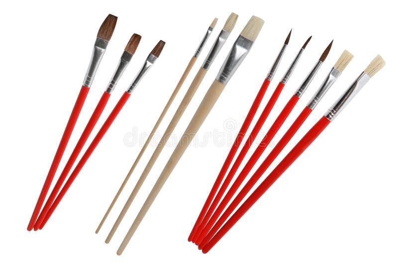 Σύνολο διαφορετικών βουρτσών χρωμάτων με την ξύλινη λαβή που απομονώνεται στοκ φωτογραφία