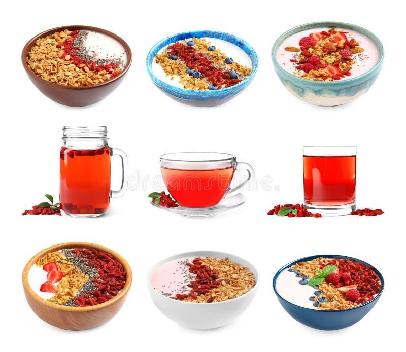 Σύνολο εύγευστων υγιών ποτού και επιδορπίων με τα μούρα goji στο λευκό στοκ εικόνες