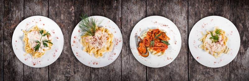 Σύνολο ζυμαρικών από τις παγκόσμιες κουζίνες Κρέας ζυμαρικών Fettuccine, ζυμαρικά θαλασσινών με τις γαρίδες, τα στρείδια, το χταπ στοκ φωτογραφίες με δικαίωμα ελεύθερης χρήσης