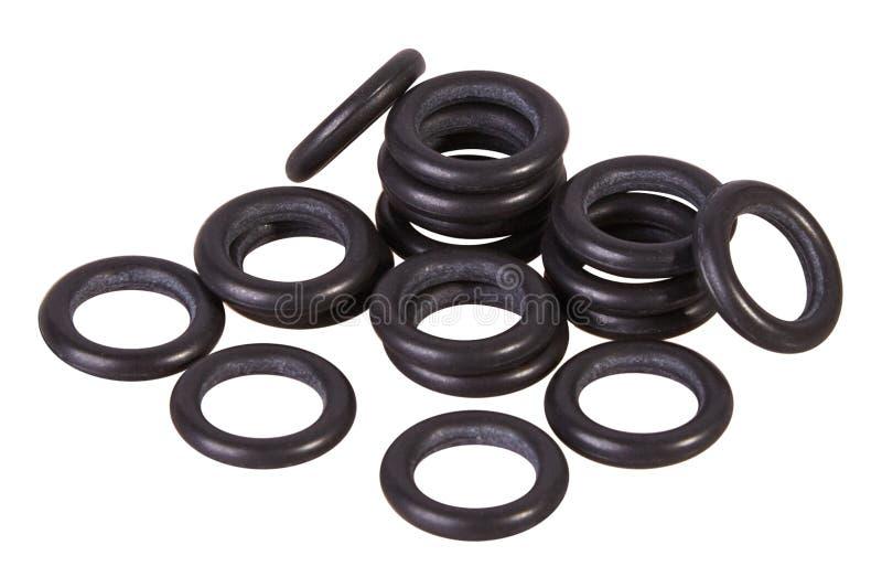 Σύνολο μαύρων στολισμάτων που απομονώνεται Παρεμβύσματα ελαίου για τους υδραυλικούς κυλίνδρους για βιομηχανικό στο άσπρο υπόβαθρο στοκ φωτογραφίες