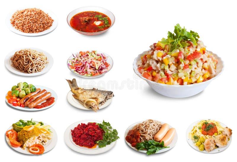 Σύνολο πολλών πιάτων με τα τρόφιμα στοκ εικόνες