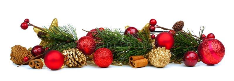 Σύνορα Χριστουγέννων των κλάδων και των μπιχλιμπιδιών στοκ εικόνες