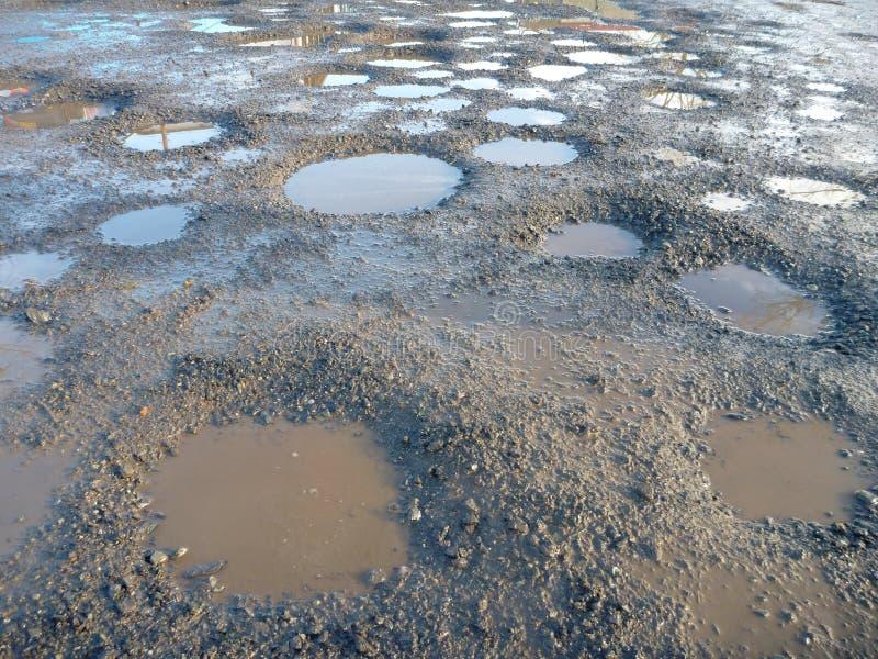 Σύνολο βρώμικων δρόμων των λιμνών λάσπης και νερού στοκ εικόνες