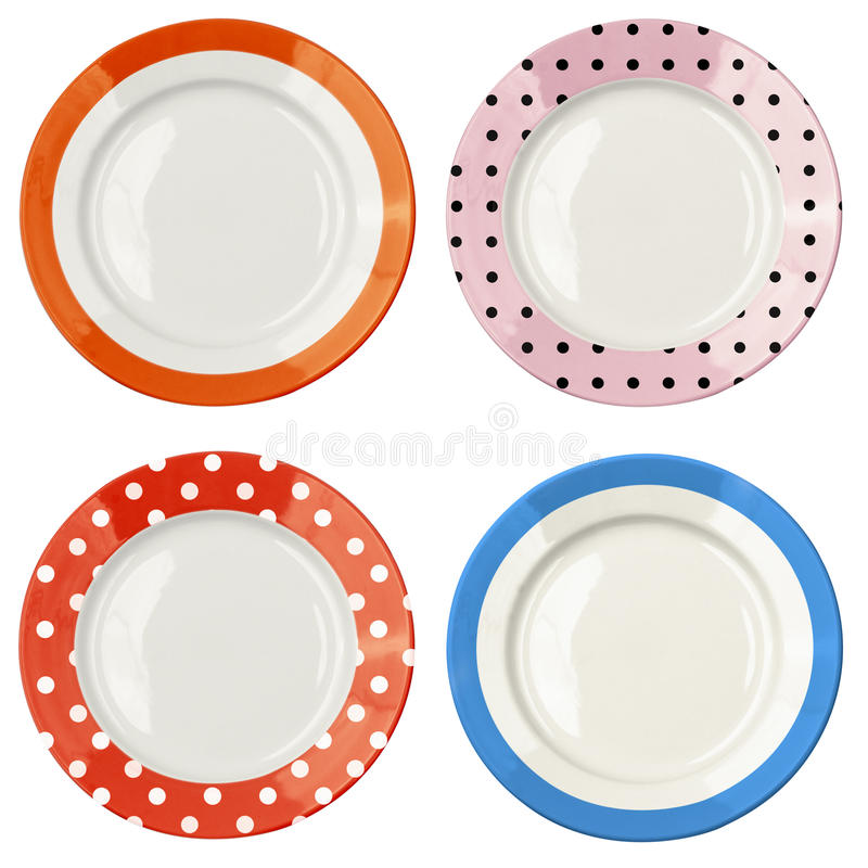 Σύνολο πιάτων χρώματος με το σχέδιο σημείων Πόλκα που απομονώνεται στοκ φωτογραφία
