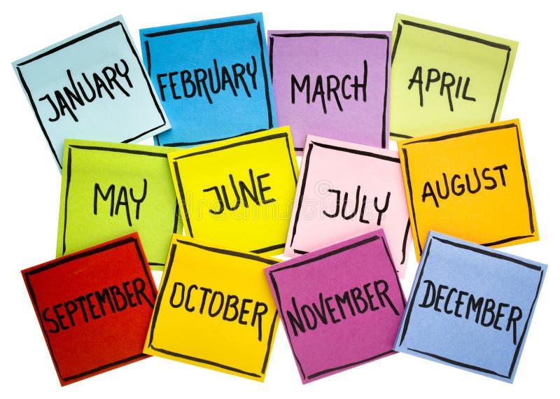 Σύνολο δώδεκα μηνών στις κολλώδεις σημειώσεις στοκ εικόνες με δικαίωμα ελεύθερης χρήσης
