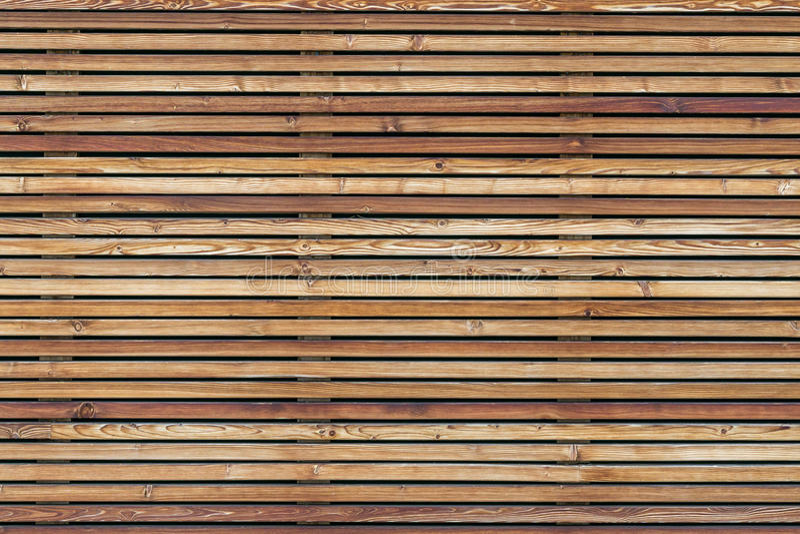 Σύσταση ενός σύγχρονου ξύλινου τοίχου φιαγμένου από slats στοκ φωτογραφία με δικαίωμα ελεύθερης χρήσης