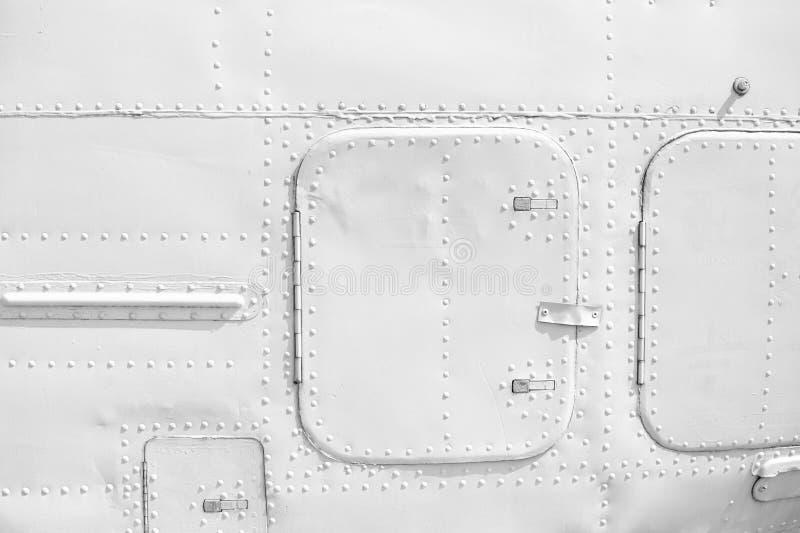 Σύσταση επένδυσης μετάλλων αεροσκαφών με τα καρφιά στοκ φωτογραφία