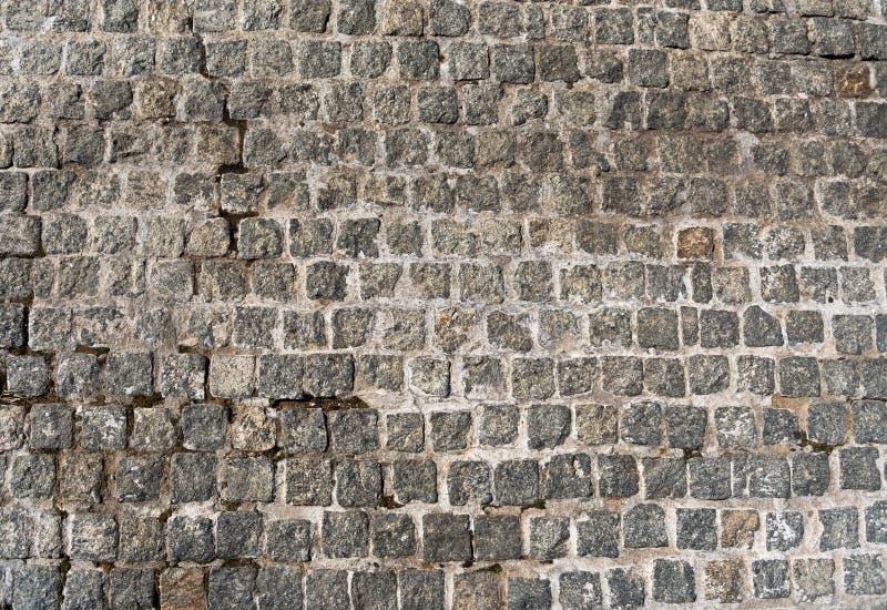 Σύσταση παλαιά γκρίζα pavers Πέτρινος δρόμος Τοπ κινηματογράφηση σε πρώτο πλάνο άποψης στοκ φωτογραφίες