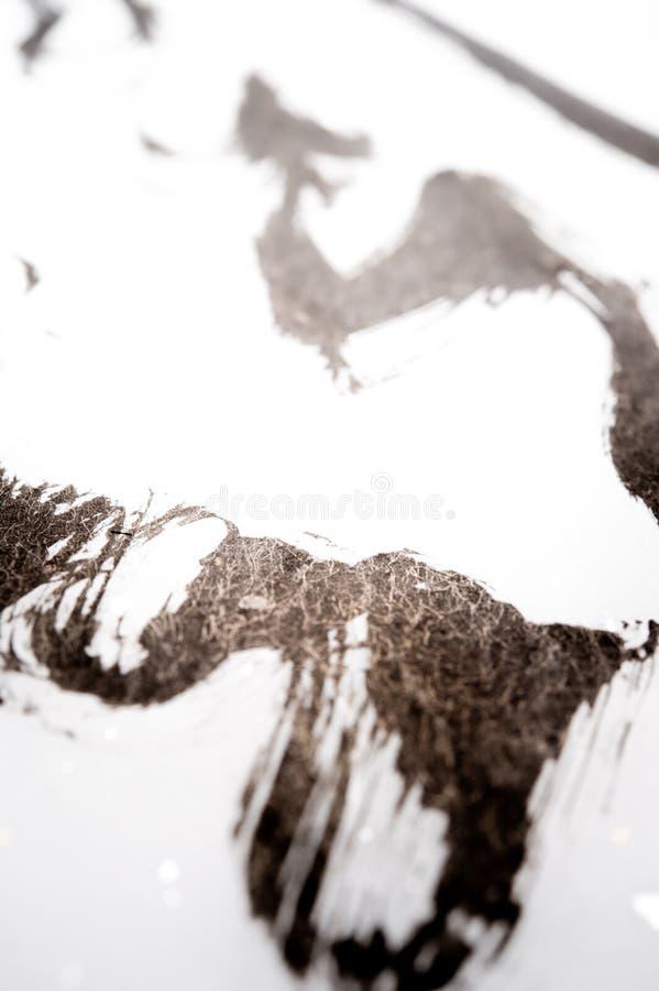 Σύσταση της ιαπωνικής καλλιγραφίας και του άσπρου ψεκασμού χρώματος στοκ φωτογραφία