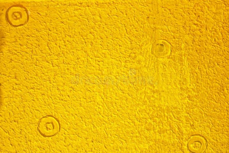Σύσταση του κίτρινου εγγράφου μουριών, το οποίο χρησιμοποίησε για να διακοσμήσει τους τοίχους στο υπόβαθρο στοκ φωτογραφία