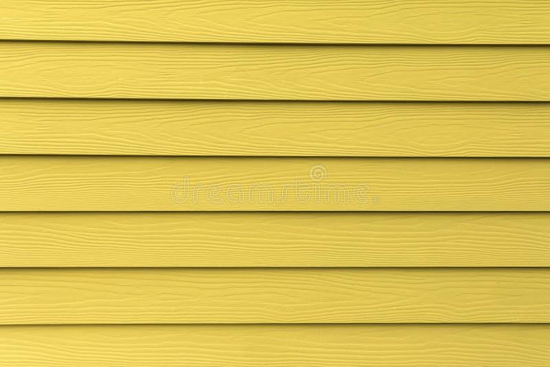 Σύσταση του κίτρινου τεχνητού ξύλου στοκ φωτογραφία