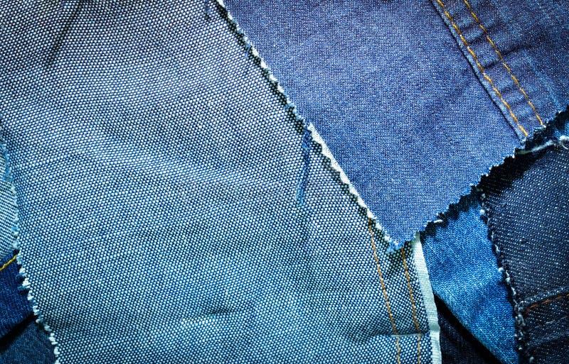 Σύσταση του κλωστοϋφαντουργικού προϊόντος τζιν παντελόνι στοκ φωτογραφία