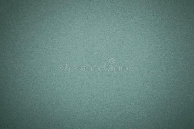 Σύσταση του παλαιού ανοικτό πράσινο υποβάθρου εγγράφου, κινηματογράφηση σε πρώτο πλάνο Δομή του πυκνού χαρτονιού χάλυβα στοκ φωτογραφίες