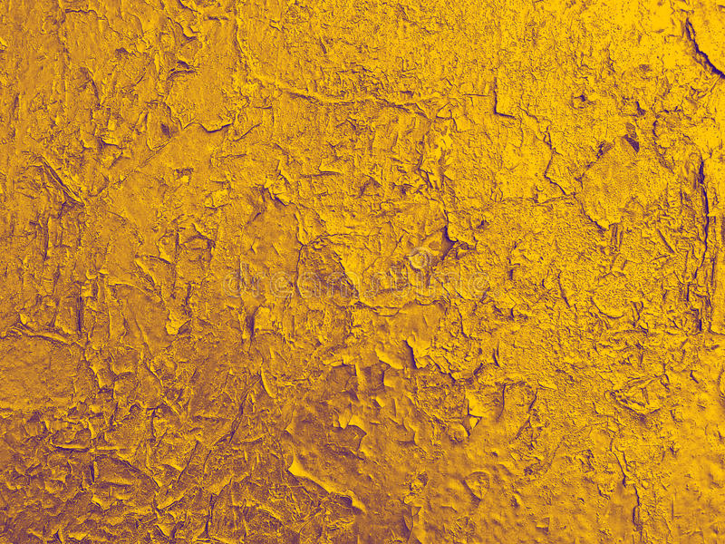 Σύσταση του παλαιού τοίχου με ένα ραγισμένο χρυσό χρώμα. στοκ εικόνα