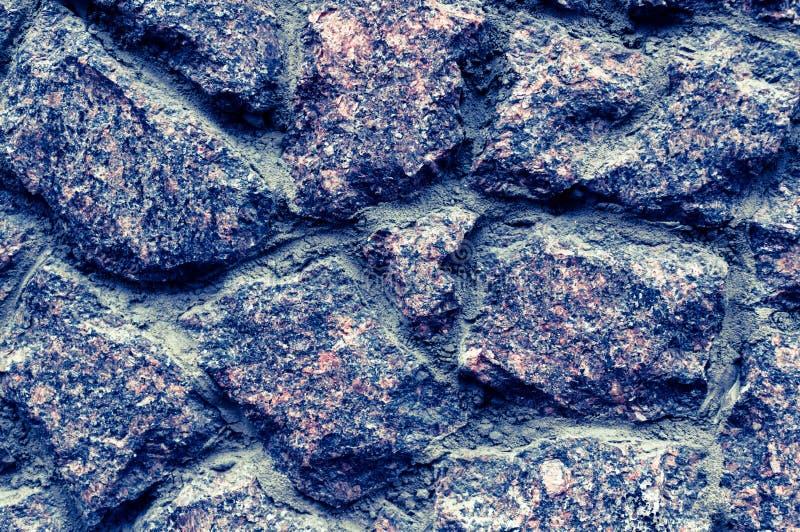Σύσταση του παλαιού τοίχου πετρών Μεγάλο σχέδιο για οποιοδήποτε σκοπό Φωτογραφία που τονίζεται στους όμορφους μπλε τόνους στοκ φωτογραφία με δικαίωμα ελεύθερης χρήσης