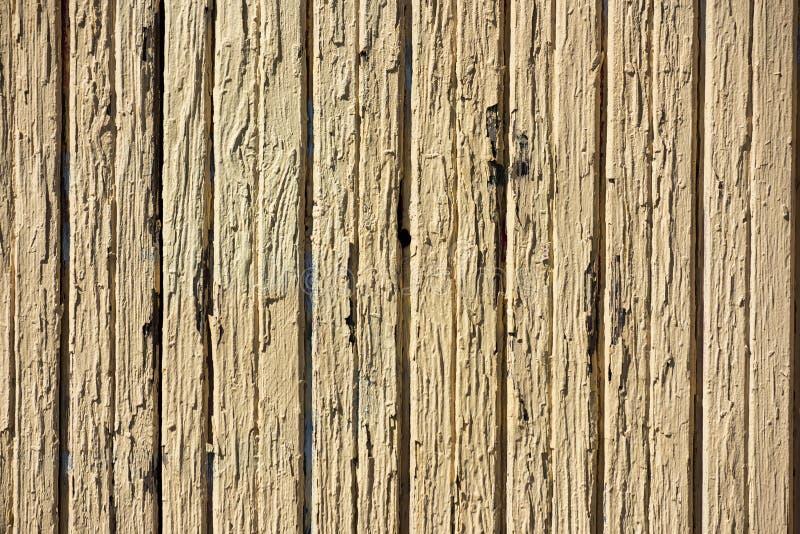Σύσταση των ξύλινων οριζόντιων παλαιών κίτρινων φθαρμένων πινάκων στοκ φωτογραφία