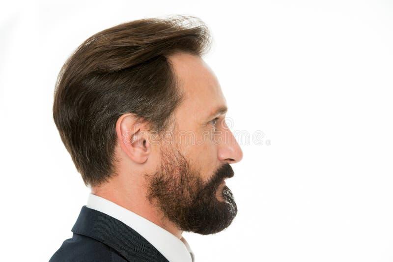 Τέλειο ύφος Το επιχειρησιακό άτομο εκαλλώπισε καλά το ώριμο άσπρο υπόβαθρο πλάγιας όψης τύπων Επιχειρηματίες hairstyle Επιχειρημα στοκ φωτογραφία