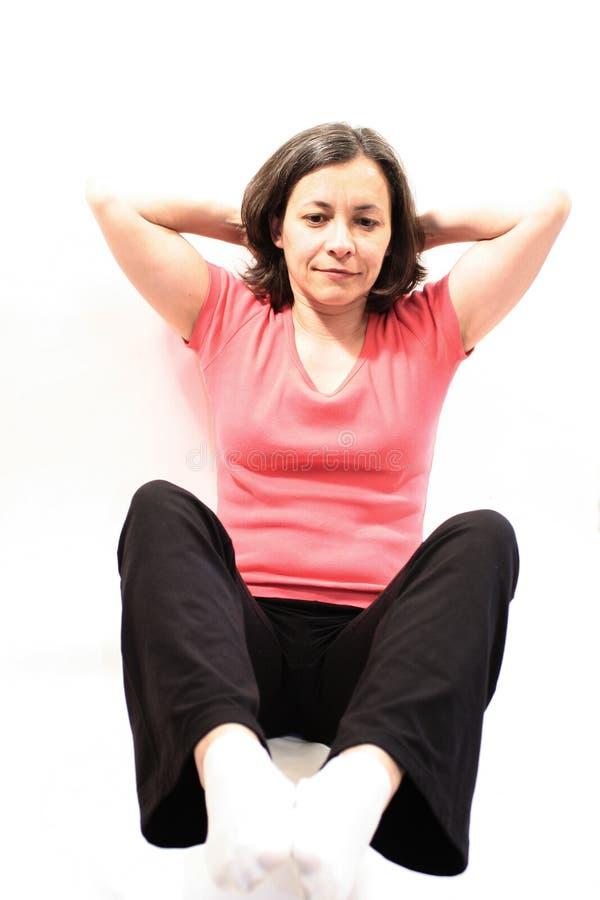 τέντωμα άσκησης στοκ εικόνα