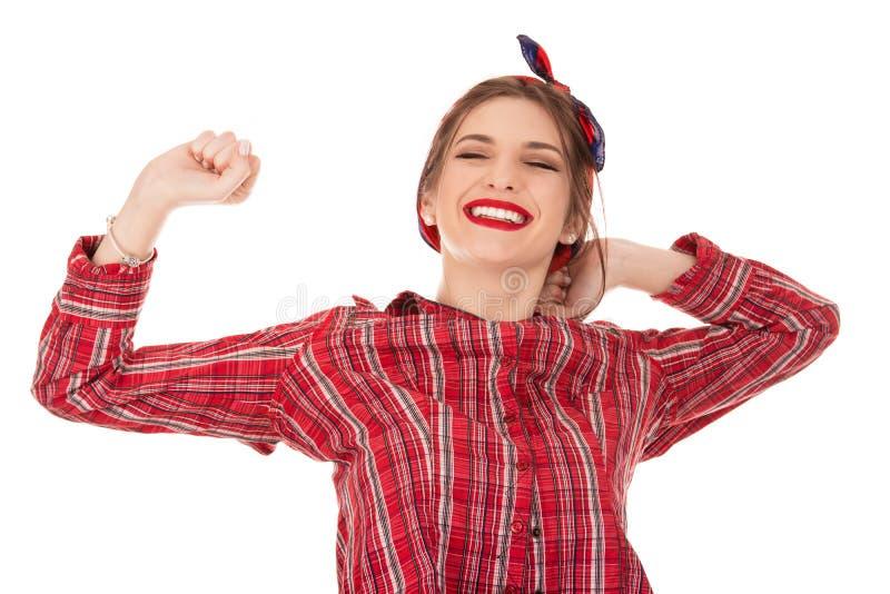 Τέντωμα γυναικών χαμόγελου νέο στοκ φωτογραφία