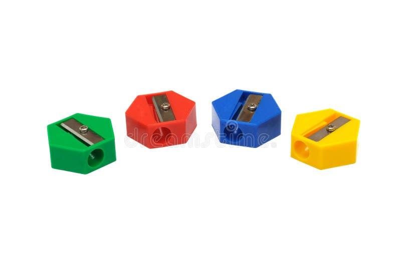Τέσσερα κομμάτια των πολλαπλάσιων χρωματισμένων ξυστρών για μολύβια στοκ εικόνες