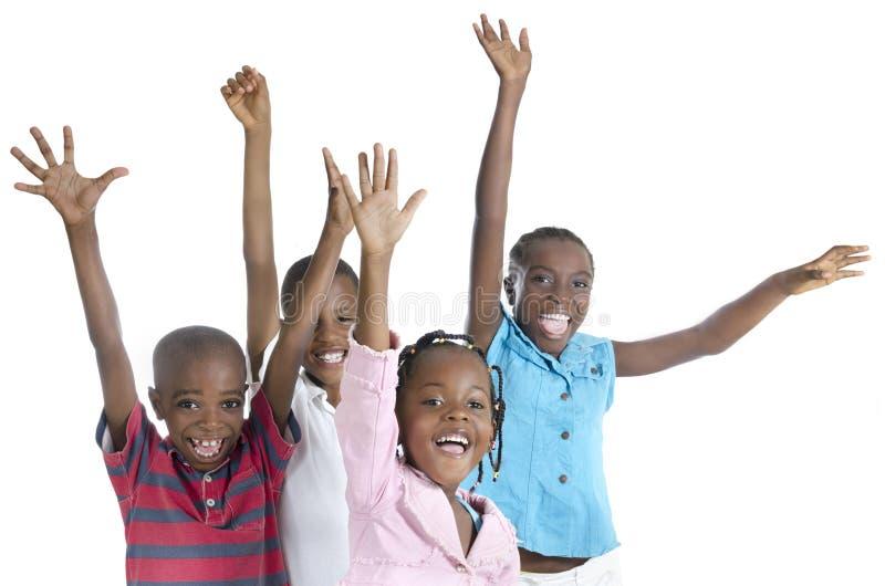 Τέσσερις ευτυχής αφρικανικός ενθαρρυντικός στοκ εικόνες